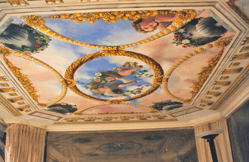 Trompe l'oeil sky ceiling with putti, above a bed, New York City.