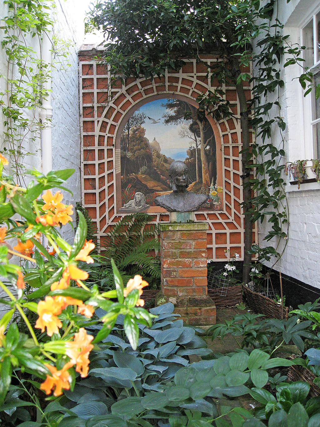 Small garden arch with view, exterior mural, Suffolk.