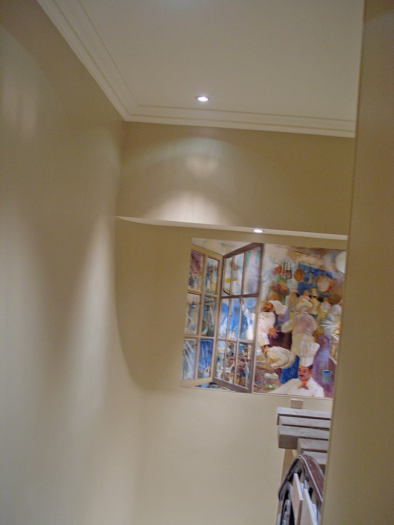 Trompe l'oeil window mural installed on the staircase to the Minstrels Gallery at the RAC Club, Pall Mall, London.