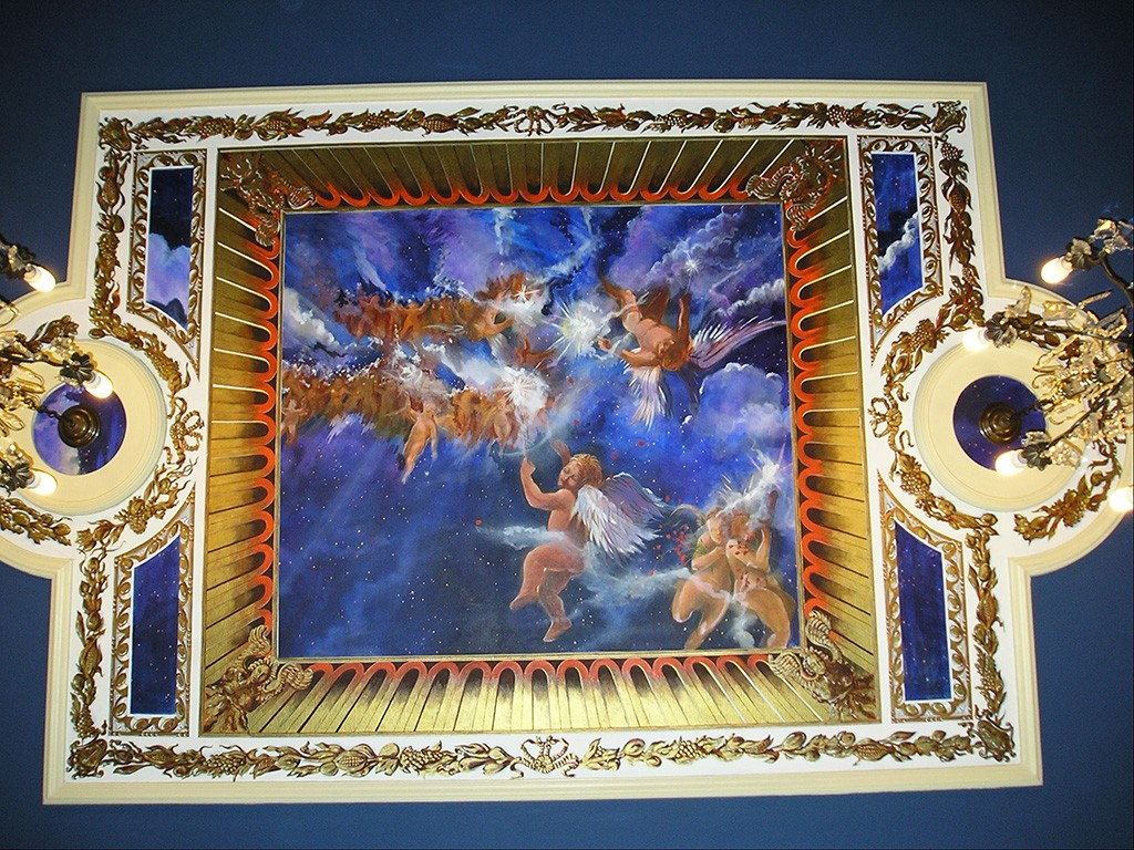 Night sky and cherub mural, with gilded trompel'oeil.