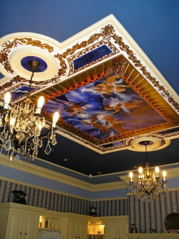 Ceiling mural, night sky and cherubs with gilded trompel'oeil.